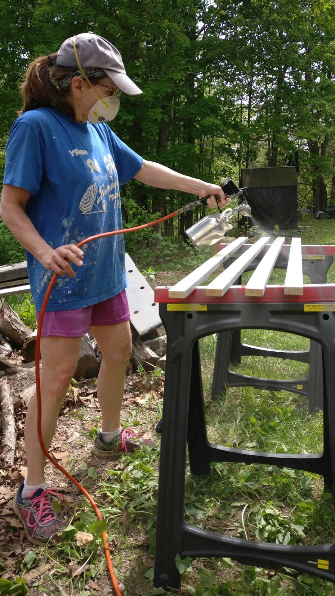 Lorrie priming the wood for the frames.