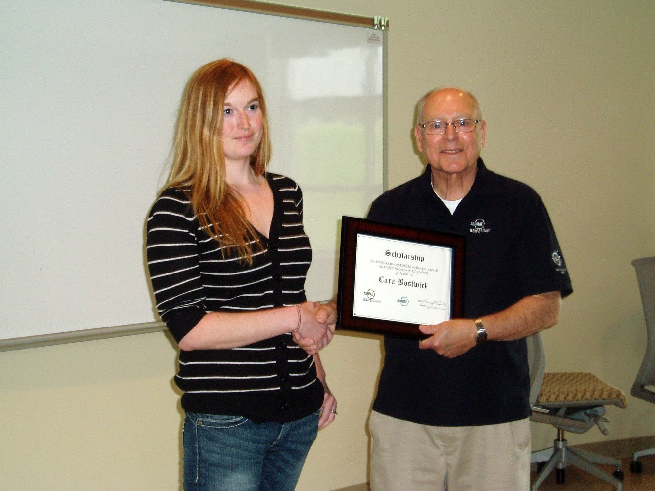 Dwight Scott presents Cara Bostwick of NBCC Fredericton a $1000 ASHRAE Scholarship from the NB/PEI Chapter.