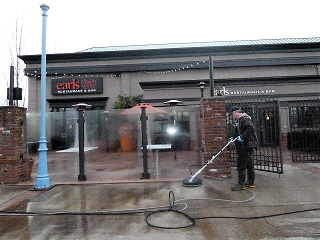 power washing concrete surface at Earl's