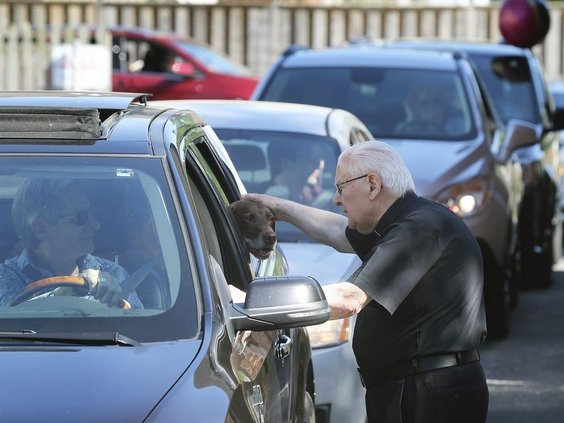 Archdeacon Matthewman greets a friend.  DAN JANISSE photo