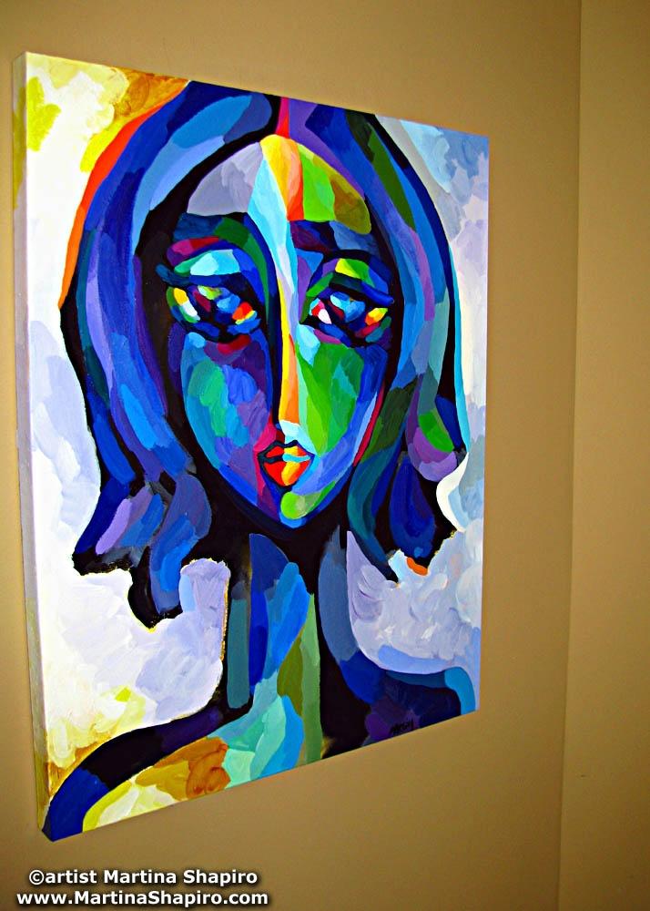 blue woman portrait on a wall - artist martina shapiro