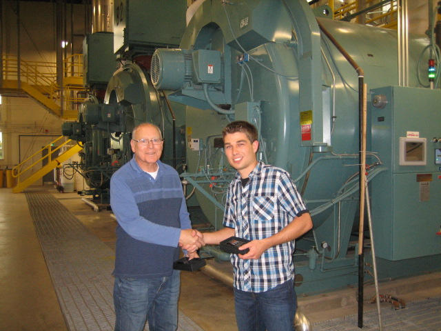 Dwight Scott presenting a token of appreciation to Fred Bernard, one of the tour guides from MCW Maricor.  Dumont Energy Centre Tour