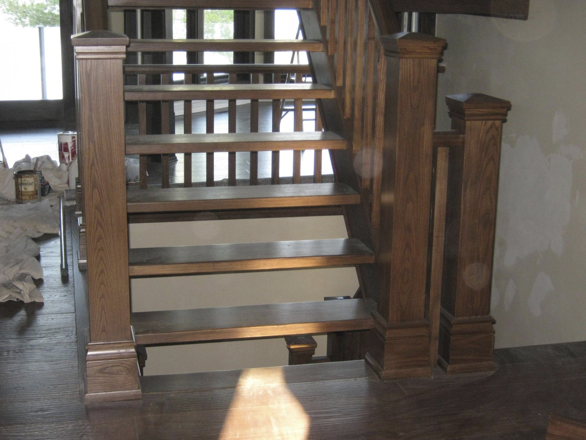 Straight ash Scandinavian style stair with closed stringers