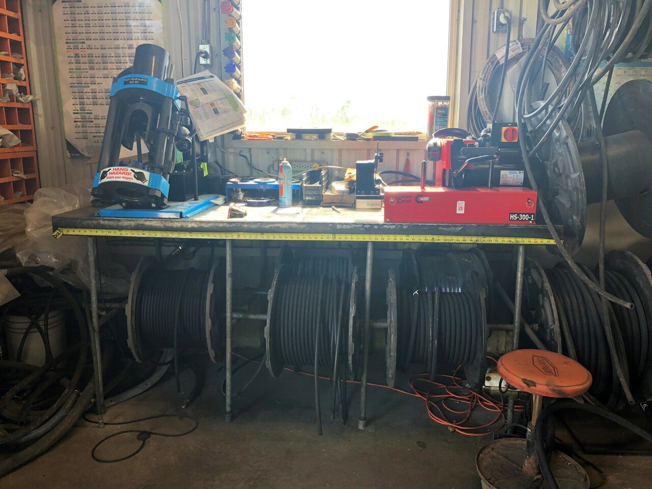 Work station to measure, cut and crimp all your hydraulic hose requirements.