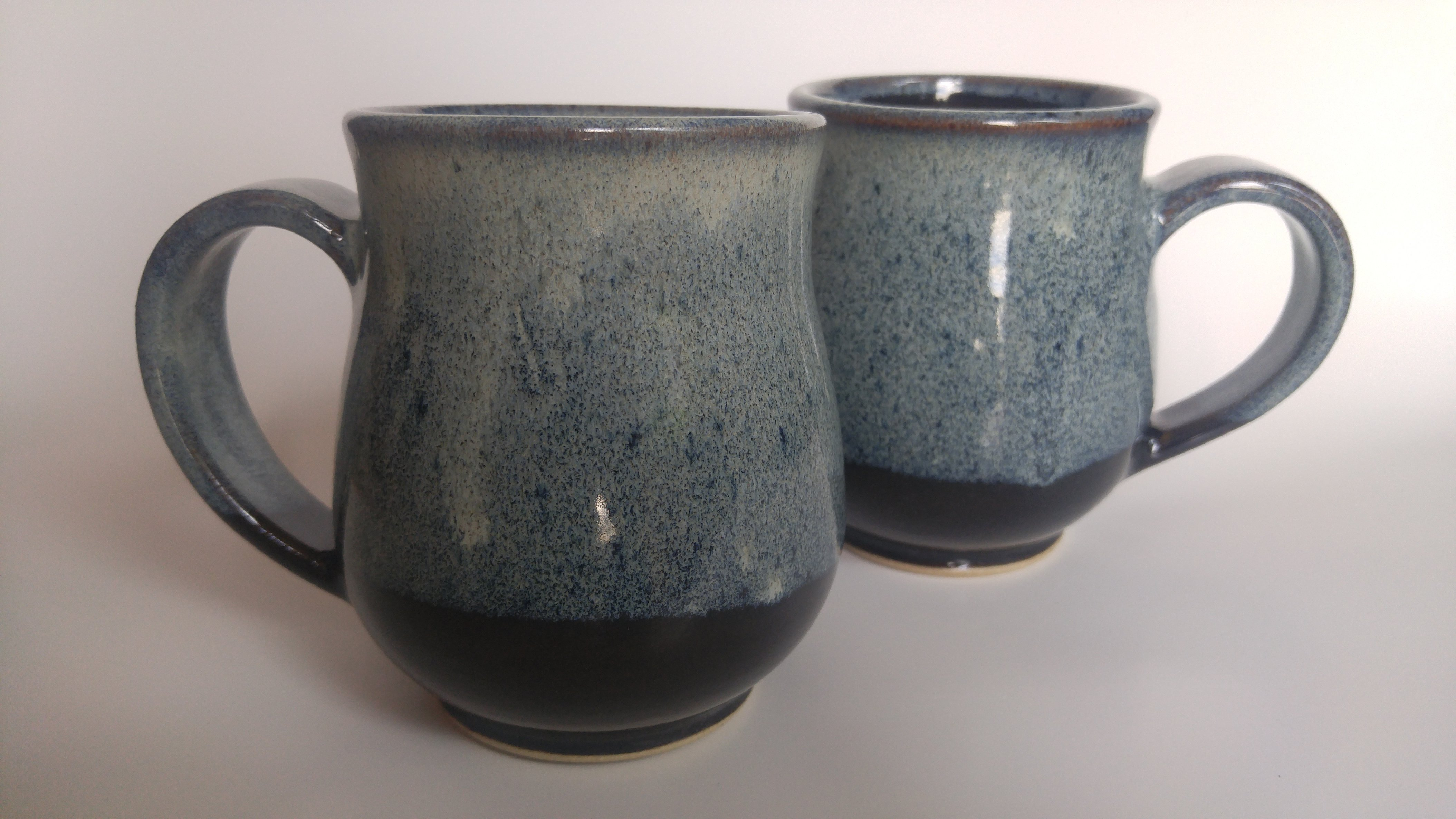 https://0901.nccdn.net/4_2/000/000/071/260/Black-with-Matte-Blue-Mugs-4216x2371.jpg