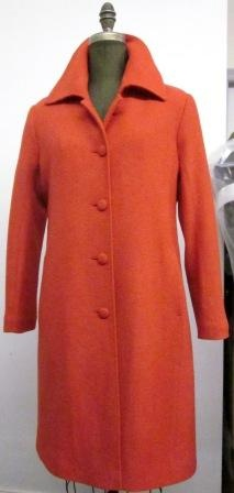 Style #9112  Sunset Orange 100% Pure Virgin Wool  Features: This classic piece has been jazzed up made in a boiled wool sunset orange. Knee length, matching covered buttons. Add a splash of colour to your wardrobe.. Includes extra buttons. Chamois lined for warmth.  Available Fabrics: Boiled Wool, Cashmere or Cashmere Blend, Alpaca 100% Pure Virgin Wool  and more.  In-Stock Colours:. Navy, Red, Black, Port, Cognac, Gray Herringbone or can be custom made in any colour or fabric.  Size: S,M,L  Price:  $ 449 and up