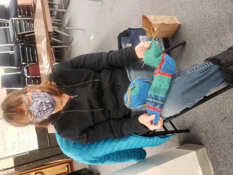 Shelley knitting colourful socks.