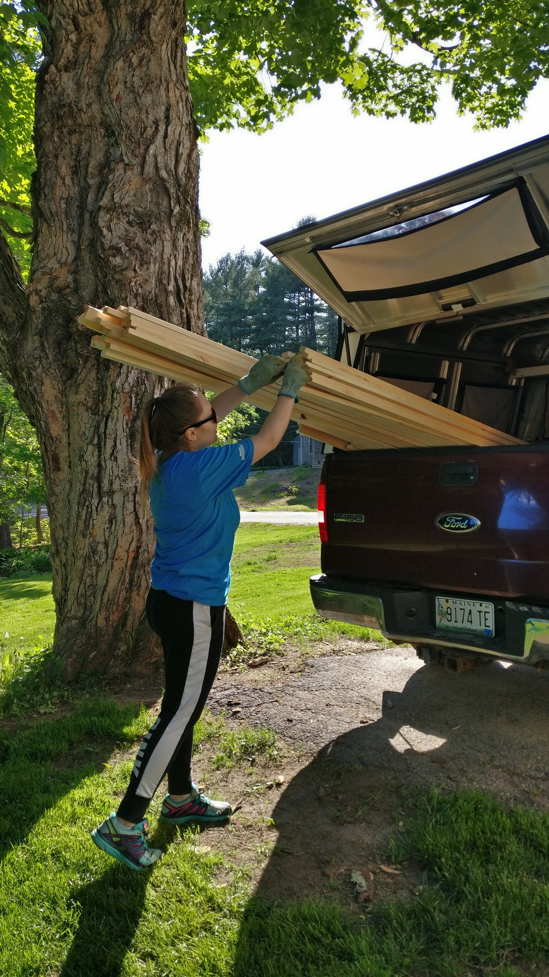 Julia helping unload the wood for the frames.