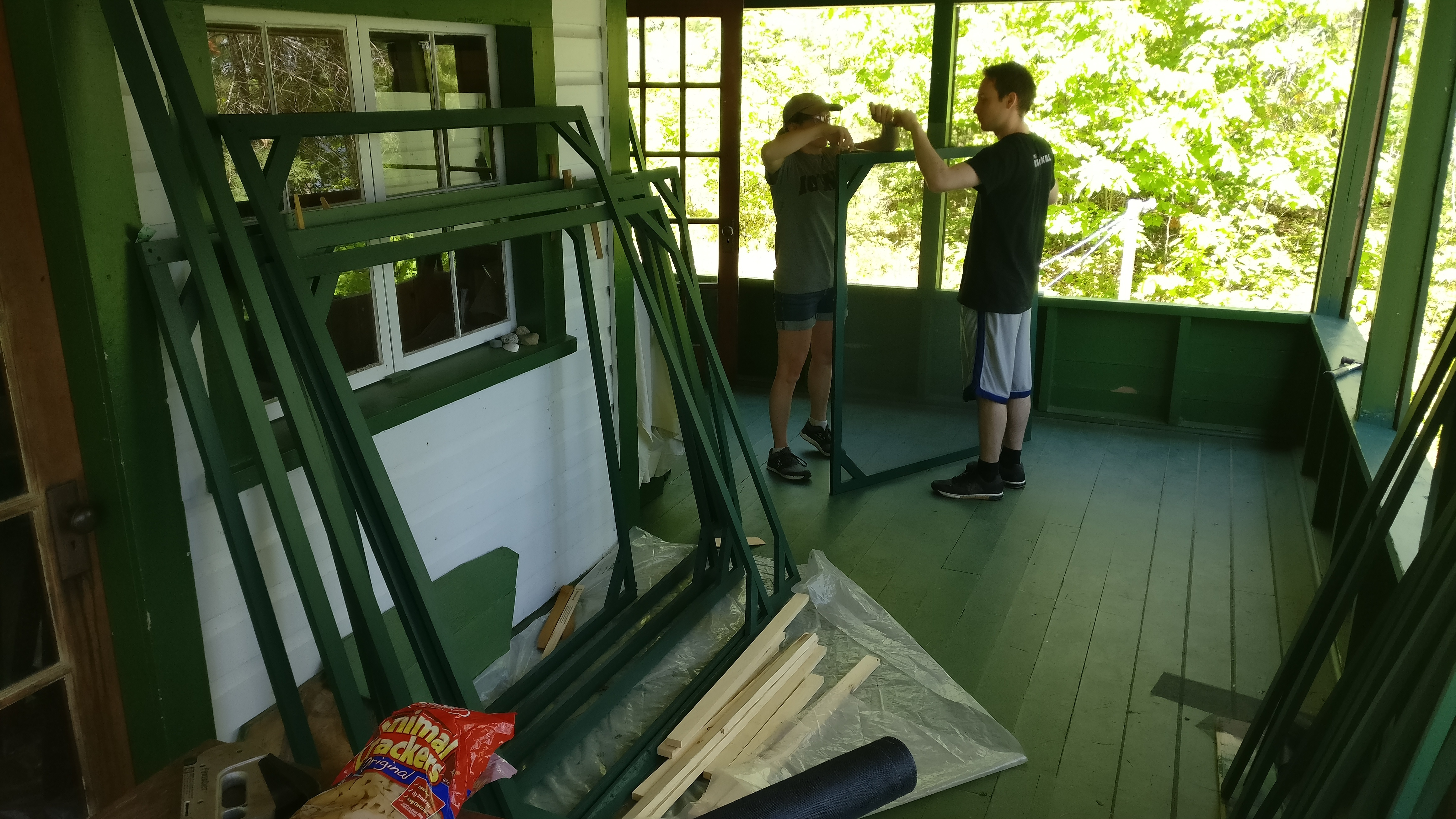 Lorrie and Johnny attaching the screens to the frames.