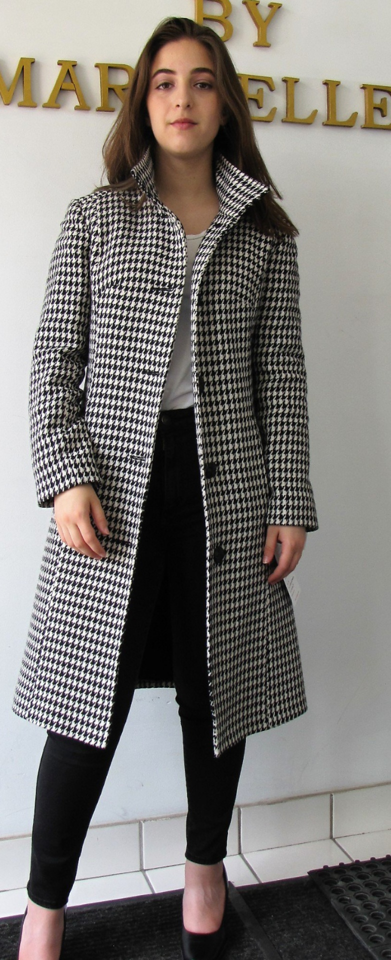 Style #B6385-17 -  Black/White Houndstooth 100% Pure Virgin Wool.   Features:  Slim fit style with front button closure.   Stand Collar. Genuine chamois lining for warmth.  Extra Button included.  In-Stock Colours:  Houndstooth or can be made in the colour of your choice.  Fabrics Available:  100% Pure Virgin Wool or can be made in the fabric of your choice.  Sizes:  S, M, L  Price $499