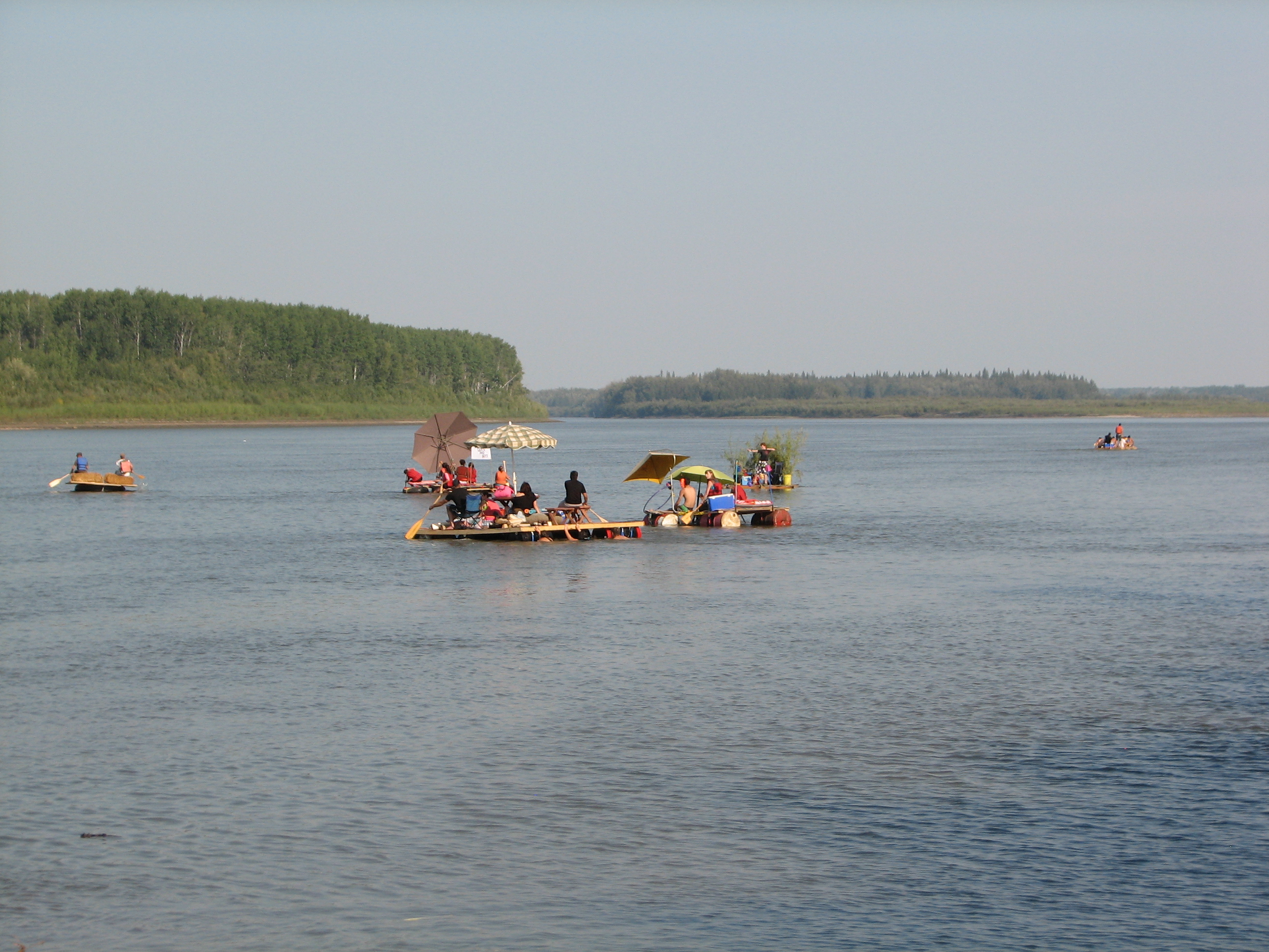 Rafts in the raft race. River days 2012. Photo Credit: Wendy Quist