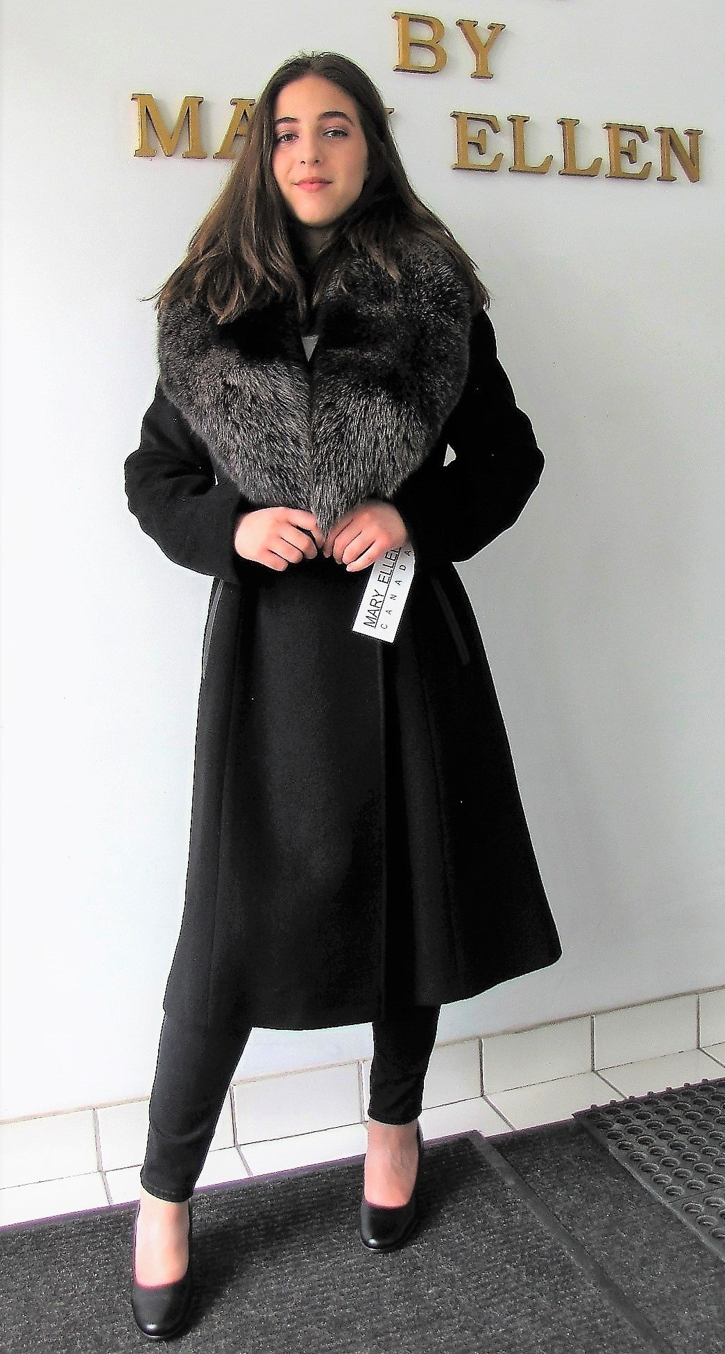 Style# 4403 Black with Snow Top Fox Collar Cashmere/Wool  Features:  Magnificent  Snowtop Fox Collar. The world seems to melt away the moment you slip it on.  Wrap style coat with self-belt that cinches the  waist, genuine leather trim, and inner tie.  Wear it with elegance, ease, and confidence that you have made an  exceptional choice. Full chamois lining.  In-Stock Colours:  Black, Red, Grey, Plum, Camel or can be made in the colour of your choice.   Various Fabrics: Cashmere and Cashmere/Wool Blends,  Alpaca blends, 100% Pure Virgin Wool  and other fine fabrics   Sizes: S, M, L   Price: $1,200 and up