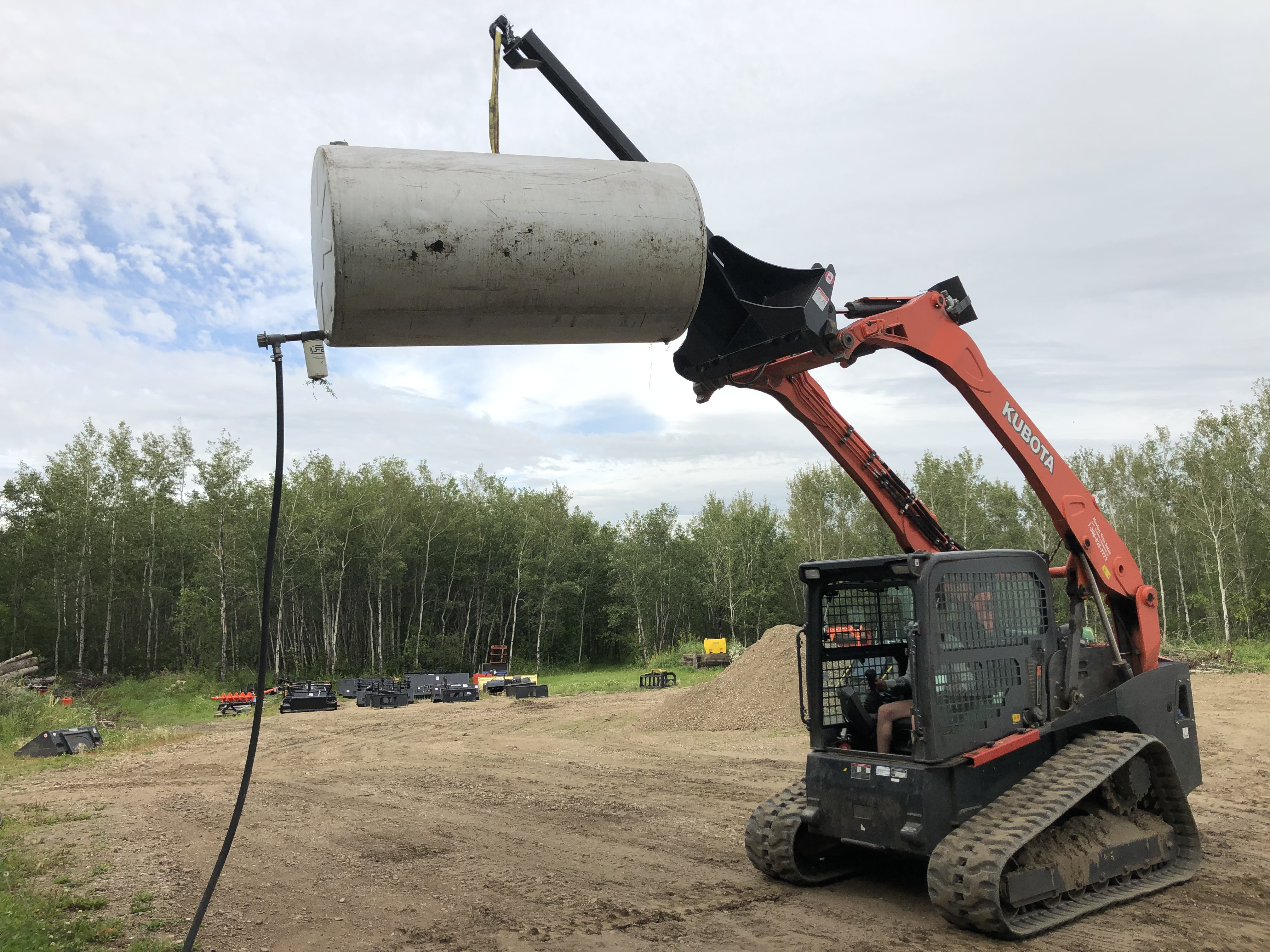 Lifting fuel tank onto stand