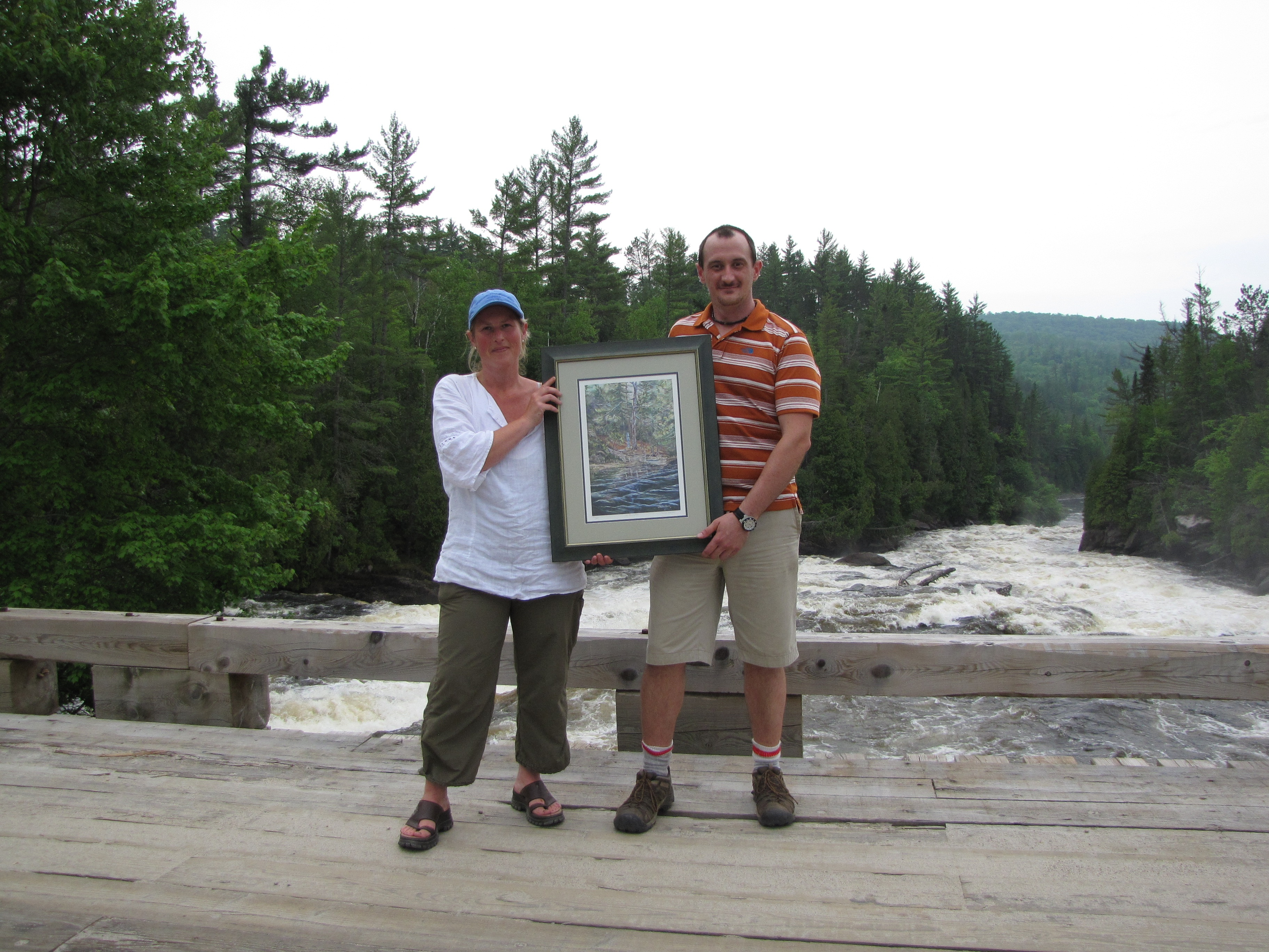 me presenting a print of one of my paintings to the Canadian Parks and Wilderness Society in 2011