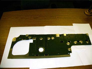 Dual Stapler Machine  Plastic mat is stapled to blank - 4 by front stapler, 5 by rear stapler.