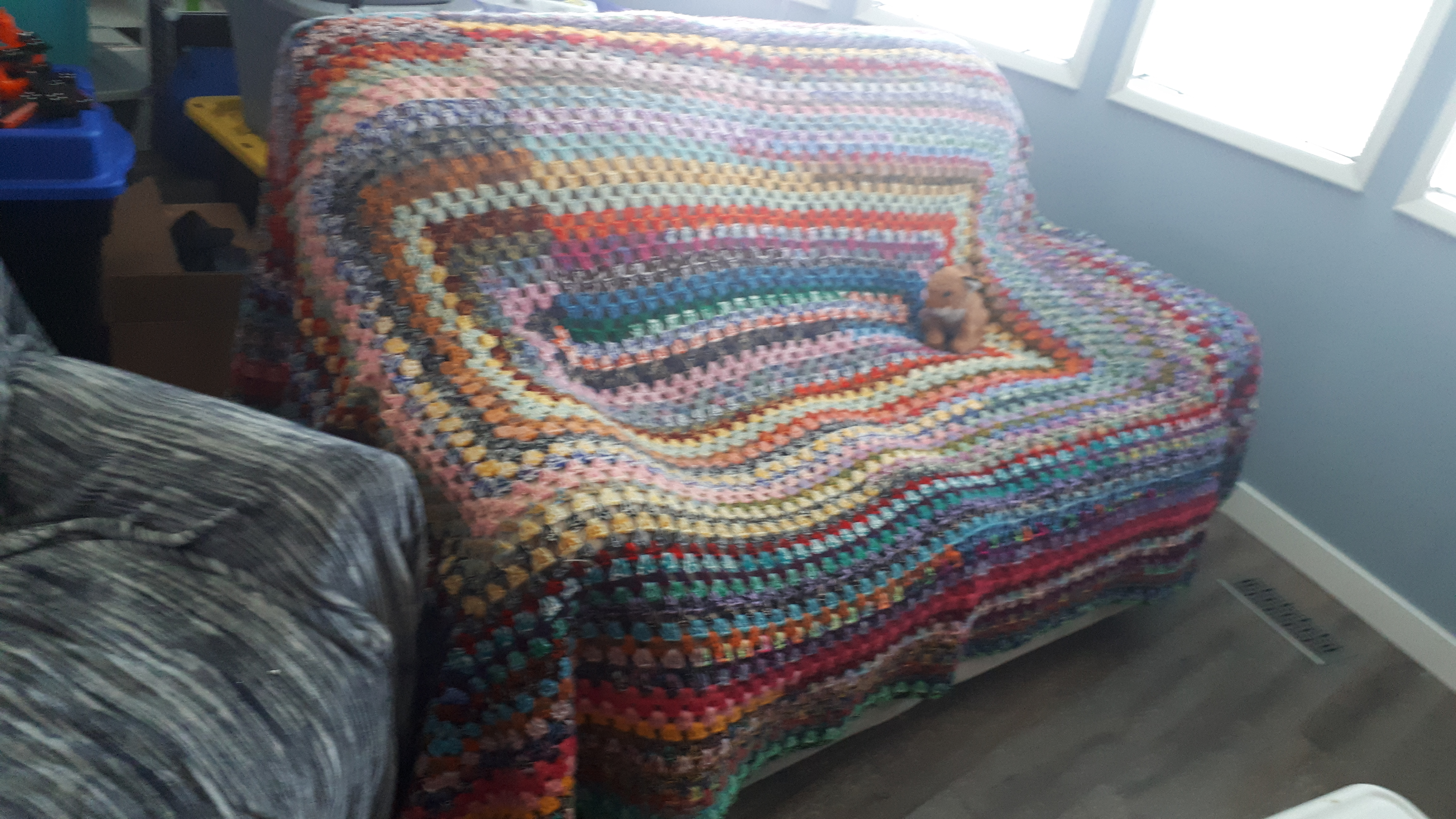 A granny rectangle blanket for the couch. 2 strand acrylic yarn randomly paired by Karen Richardson.
