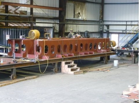 The first section of the keel module in the fabrication shop.  Large sections of the ferry were fabricated and assembled in the site fabrication shops and then taken to the lake shore build-grid for final assembly on the vessel.