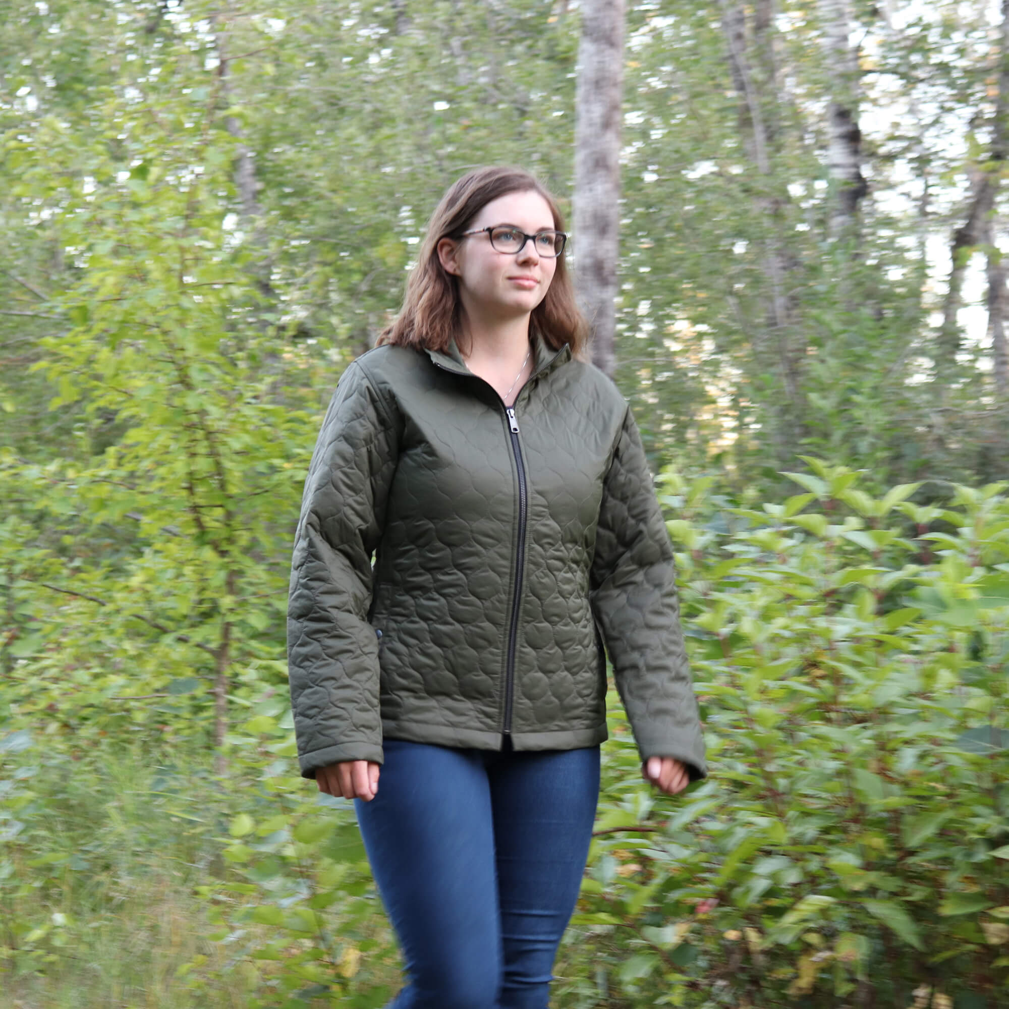 https://0901.nccdn.net/4_2/000/000/084/3b1/wj29-young-woman-walking-in-the-woods-in-a-quilted-jacket.jpg