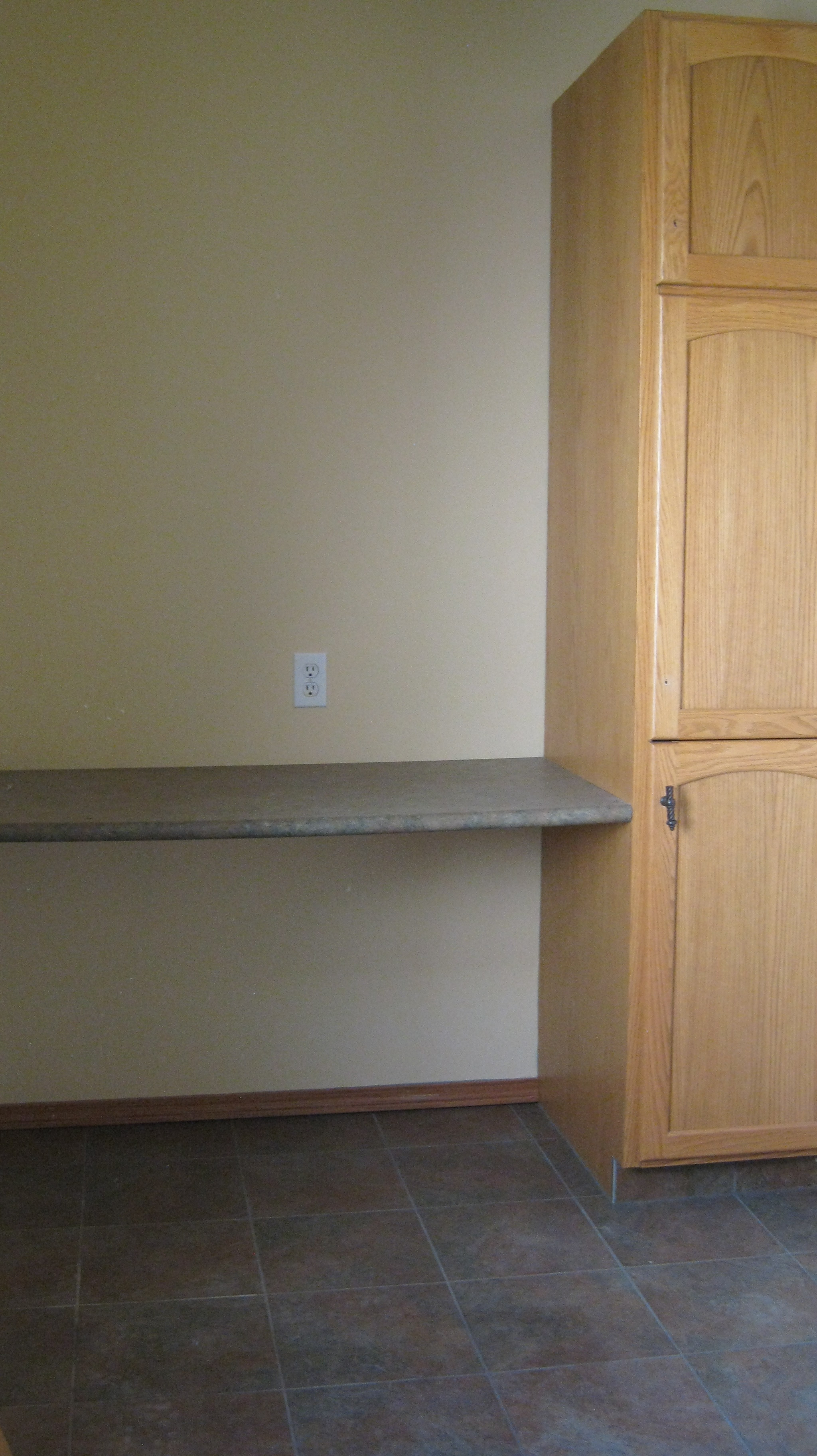 Folding shelf in laundry room
