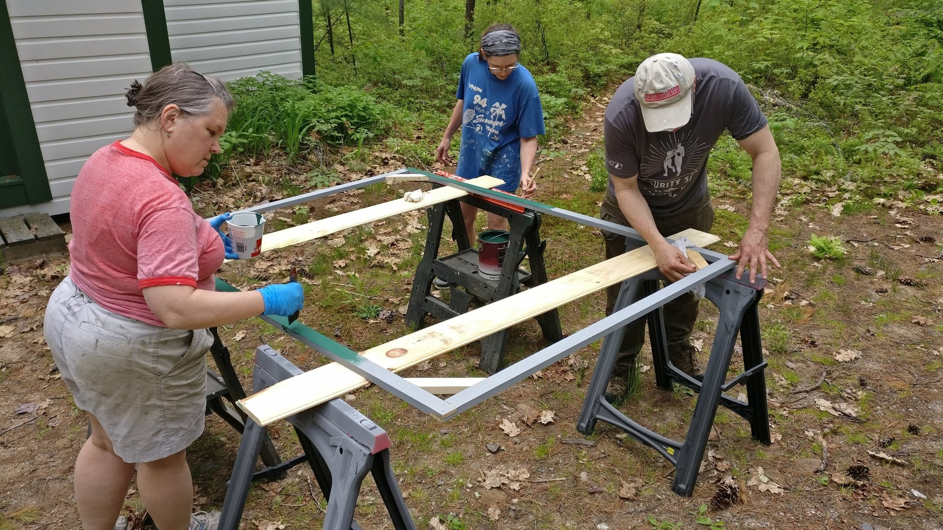 Cath, Clint, and Lorrie painting the frames.