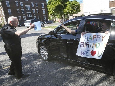 Archdeacon Matthewman greets a carload of participants. DAN JANISSE photo