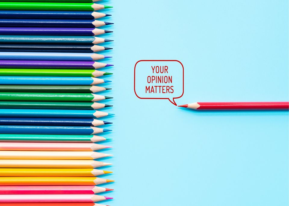 "coloured pencil crayon sin a row with a red one  writing the saying ""your opinion matters"""