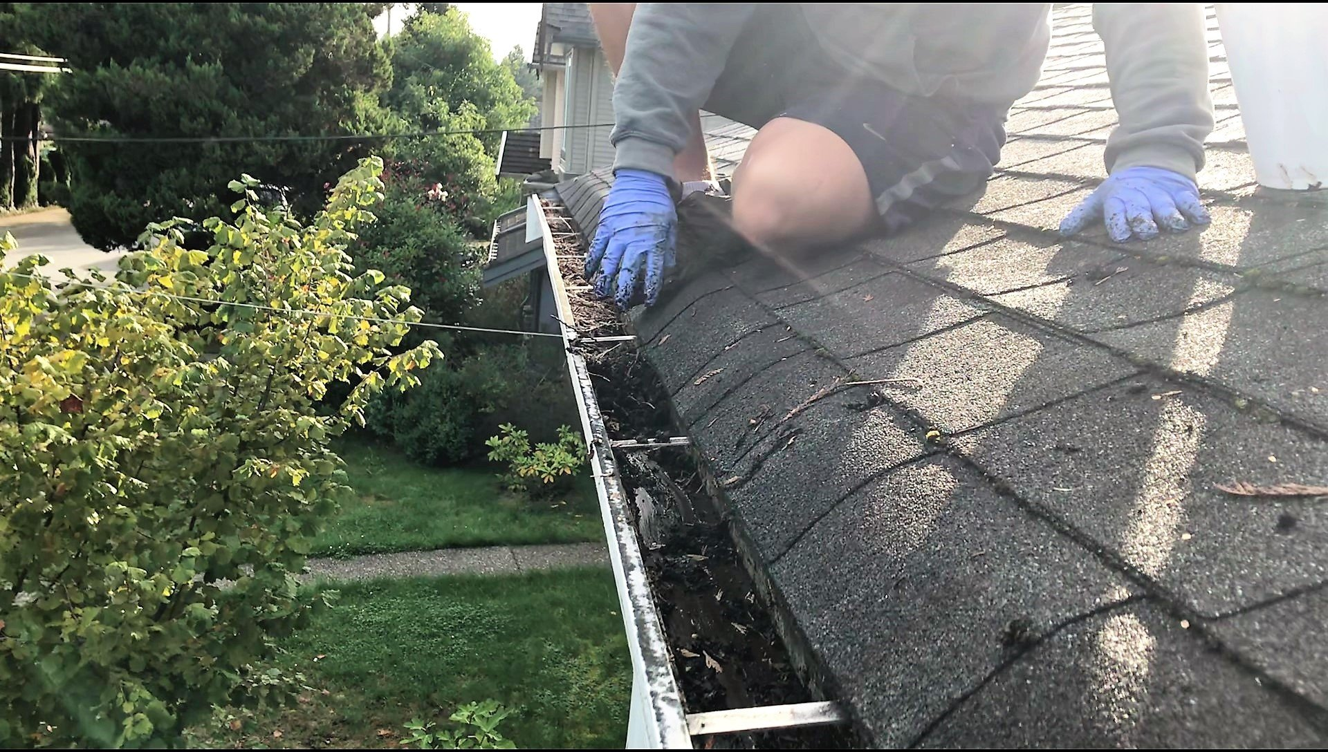 cleaning gutters from the roof line